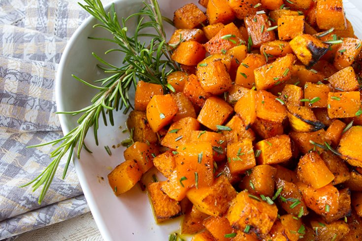 Butternut squash is flavored with maple syrup and cinnamon and then oven roasted to a golden brown perfection.