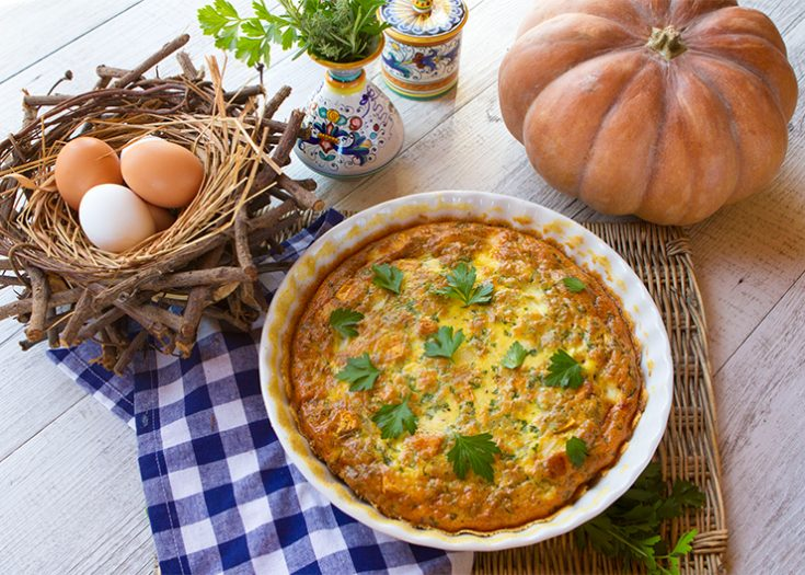 A hearty quiche stuffed with vegetables.