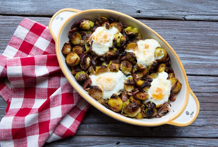 Caramelized sprouts are topped with eggs in this vegetable based main entree.