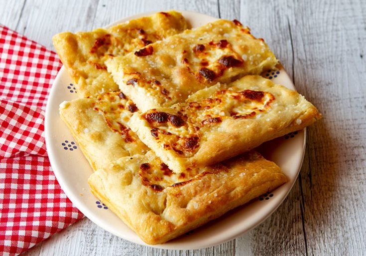 A tender, golden brown flatbread from Liguria with a topping of creamy cheese.