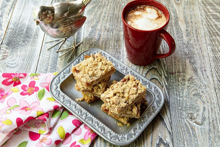 Crumbly bars made with oats and almonds with a tart rhubarb filling.