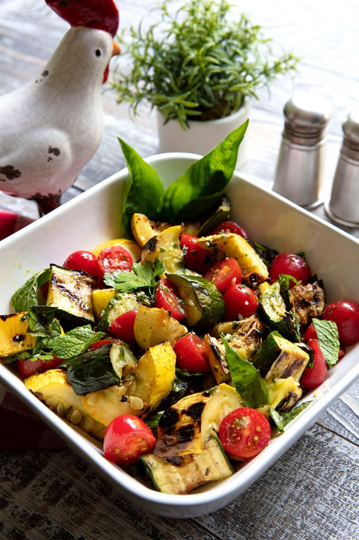 Choose small zucchini and summer squash to grill for a smoky flavor in this end of summer salad.