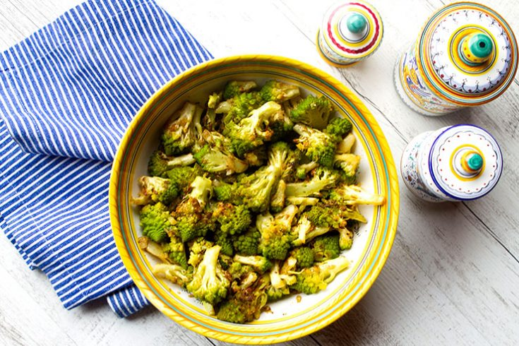 Romanesco cauliflower is a bright green vegetables with a delicate, slightly nutty flavor.