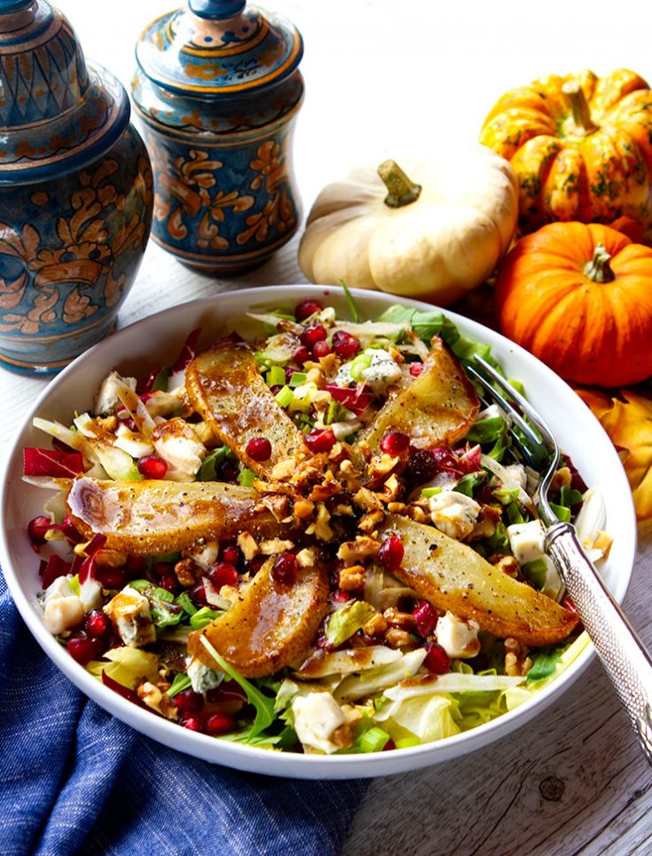 A fall salad pairing sweet roasted pears with bitter greens, and creamy Gorgonzola cheese.