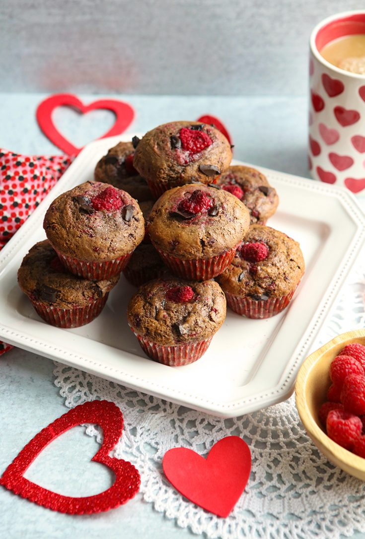 Moist chocolate muffins studded with dark chocolate pueces and raspberries.