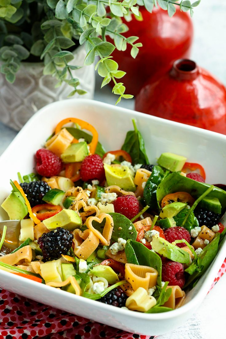 A crunchy, colorful pasta salad filled with sweet berries, creamy avocado, and crunchy vegetables.
