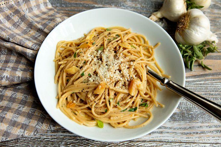 A rich, creamy pasta dish made with garlic prepared three ways.