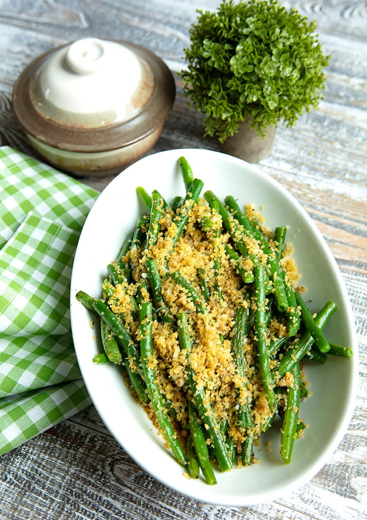 Tender crisp green beans are topped with an anchovy and garlic crumb topping creating an easy and very tasty veggie side.