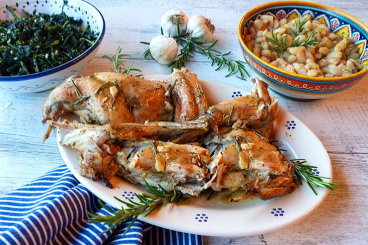 Tender Tuscan rabbit basted with white wine and flavored with rosemary and garlic.