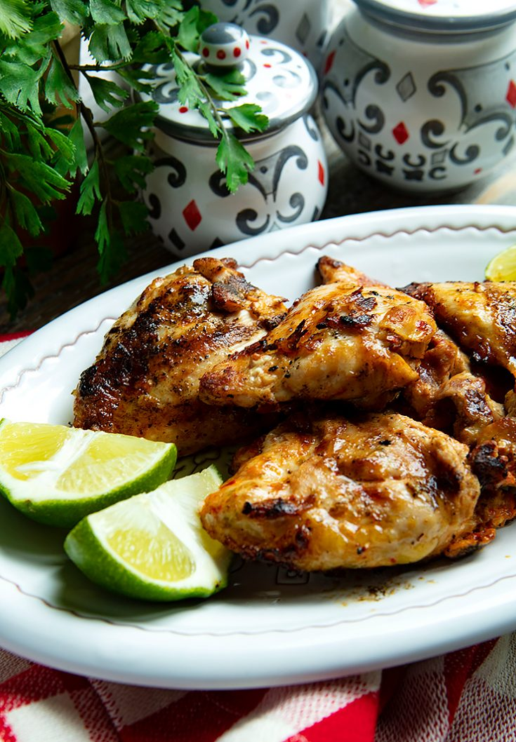 Tender, spicy marinaded chicken thighs are grilled until golden brown in this easy recipe.