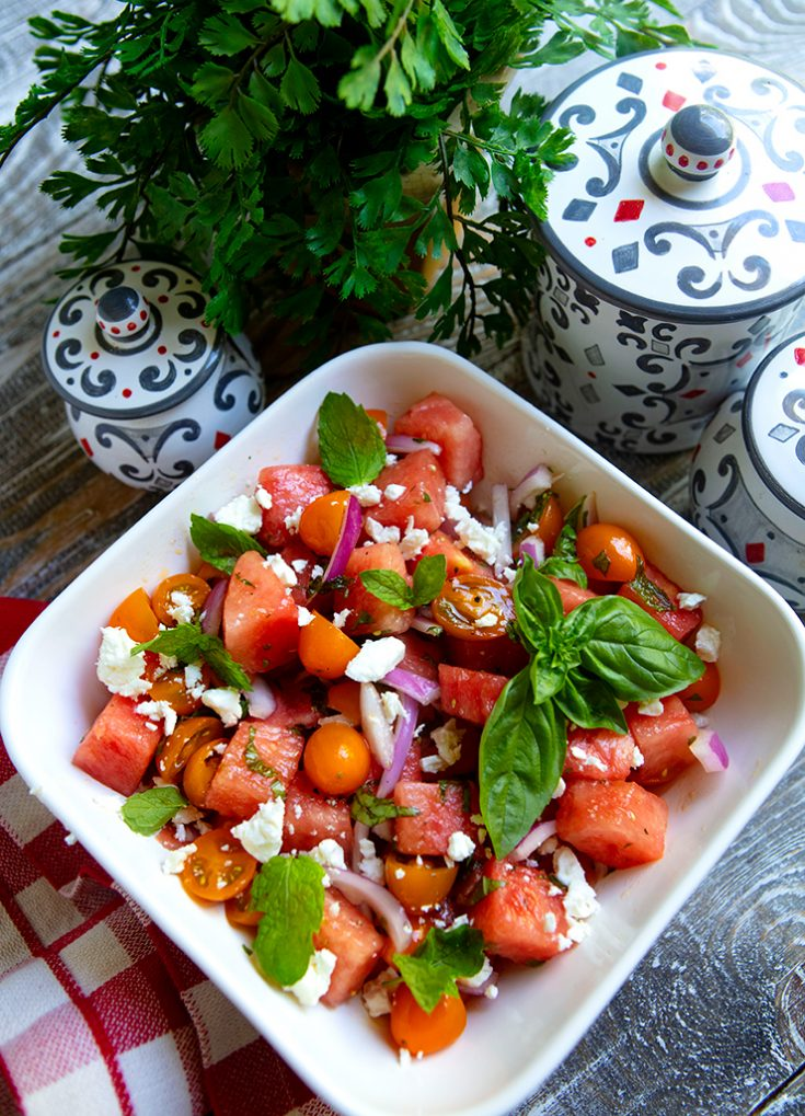 A refreshing summer salad combining ripe tomatoes with watermelon.