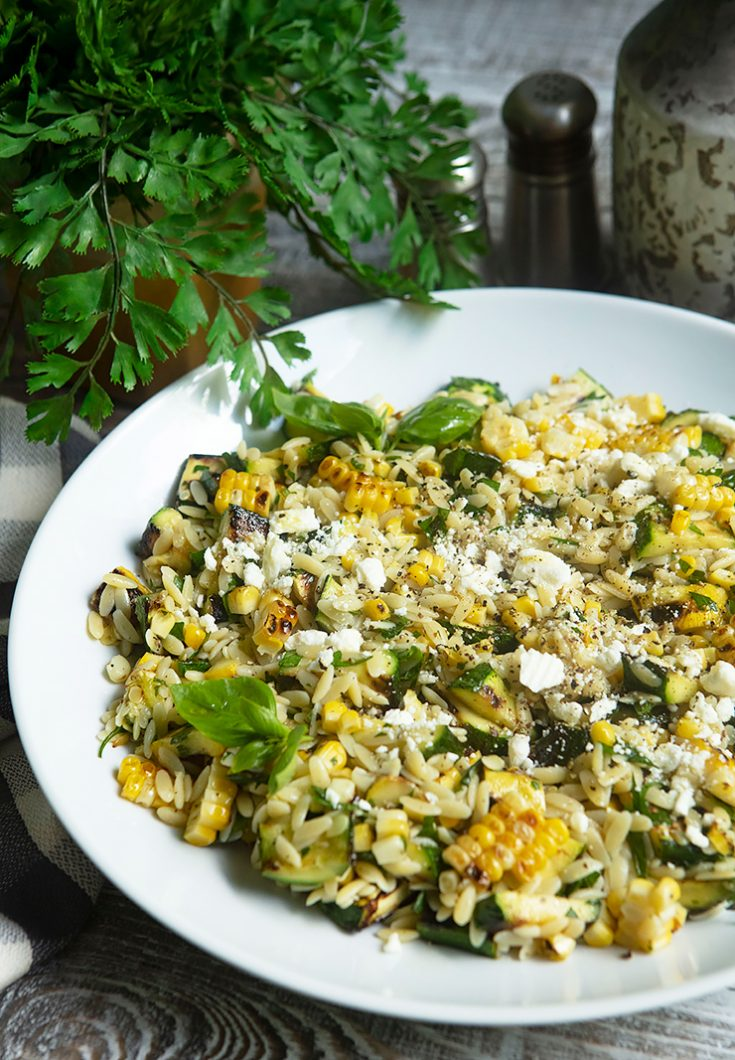 Grilling vegetables until lightly charred adds a lot of flavor to this easy orzo salad.