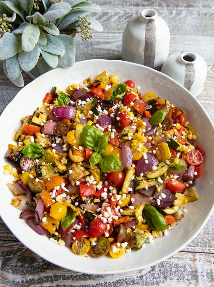 Grilling the vegetables first creates a full flavored salad that works well as a side dish for any main course.