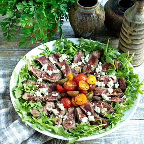 Beef Tagliata With Arugula, Tomatoes, & Gorgonzola Crumbles